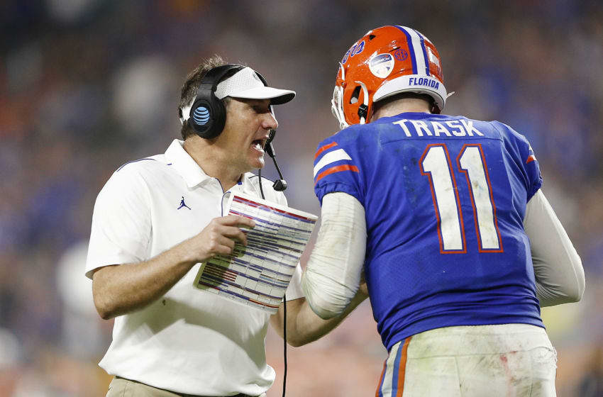 MIAMI, FLORIDA - DECEMBER 30: Head coach Dan Mullen of the Florida Gators talks with Kyle Trask #11 against the Virginia Cavaliers during the second half of the Capital One Orange Bowl at Hard Rock Stadium on December 30, 2019 in Miami, Florida. (Photo by Michael Reaves/Getty Images)