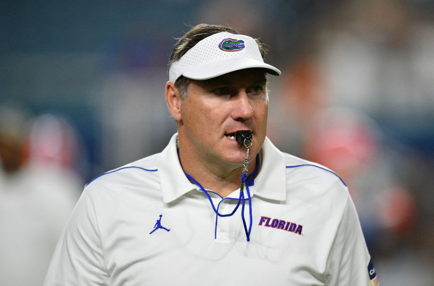 MIAMI, FLORIDA - DECEMBER 30: Head Coach Dan Mullen of the Florida Gators on the field during warm ups prior to the Capital One Orange Bowl against the Virginia Cavaliers at Hard Rock Stadium on December 30, 2019 in Miami, Florida. (Photo by Mark Brown/Getty Images)