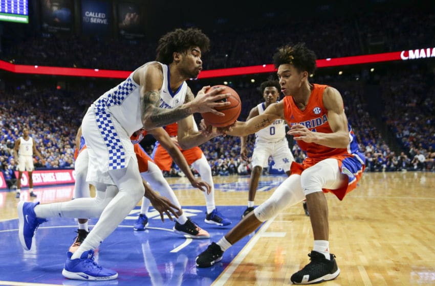 LEXINGTON, KENTUCKY - FEBRUARY 22: Nick Richards #4 of the Kentucky Wildcats loses control of the ball while guarded by Tre Mann #1 of the Florida Gators at Rupp Arena on February 22, 2020 in Lexington, Kentucky. (Photo by Silas Walker/Getty Images)