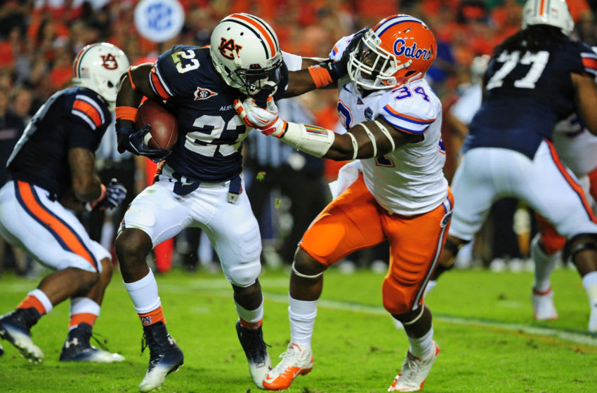 AUBURN, AL - OCTOBER 15: Onterio McCalebb #23 of the Auburn Tigers is tackled by Lerentee McCray #34 of the Florida Gators at Jordan-Hare Stadium on October 15, 2011 in Auburn, Alabama. Photo by Scott Cunningham/Getty Images)