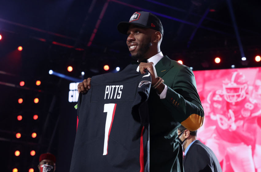 CLEVELAND, OHIO - APRIL 29: Kyle Pitts poses onstage after being selected fourth by the Atlanta Falcons during round one of the 2021 NFL Draft at the Great Lakes Science Center on April 29, 2021 in Cleveland, Ohio. (Photo by Gregory Shamus/Getty Images)