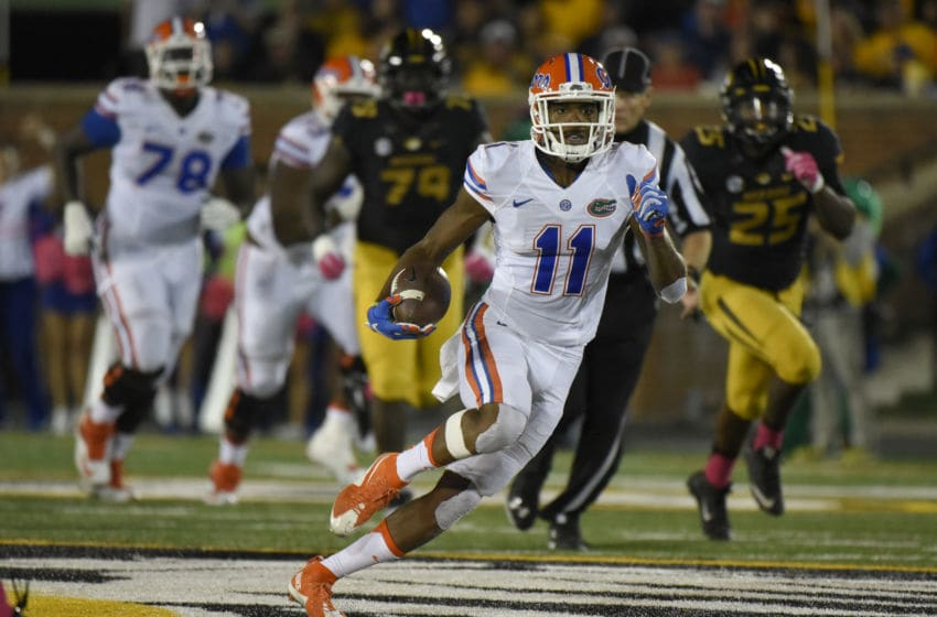 COLUMBIA , MO - OCTOBER 10: Wide receiver Demarcus Robinson #11 of the Florida Gators picks up a first down as he runs against the Missouri Tigers in the third quarter at Memorial Stadium on October 10, 2015 in Columbia, Missouri. (Photo by Ed Zurga/Getty Images)
