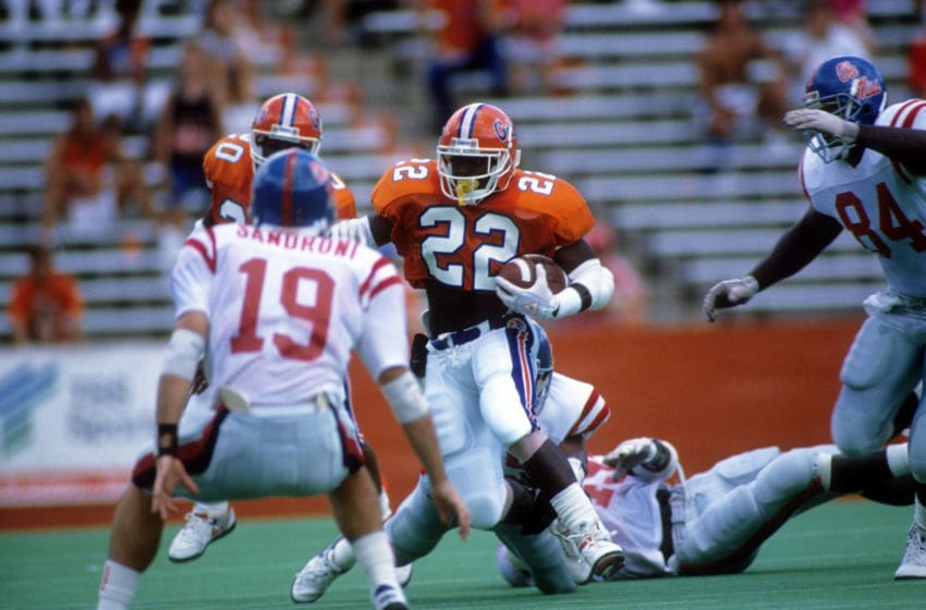 GAINSVILLE, FL - SEPTEMBER 9: Running back Emmitt Smith #22 of the Florida Gators runs with the ball during a game against the Ole Miss Rebels at Ben Hill Griffin Stadium on September 9,1989 in Gainsville, Florida. The Rebels defeated the Gators 24-19. (Photo by Allen Dean Steele/Getty Images)