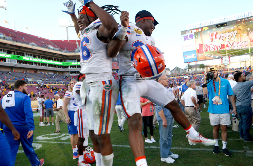 TAMPA, FL - JANUARY 2: Defensive back Marcell Harris #26 of the Florida Gators and defensive back Chauncey Gardner #23 celebrate the Gators' 30-3 win over the Iowa Hawkeyes at the conclusion of the Outback Bowl NCAA college football game on January 2, 2017 at Raymond James Stadium in Tampa, Florida. (Photo by Brian Blanco/Getty Images)