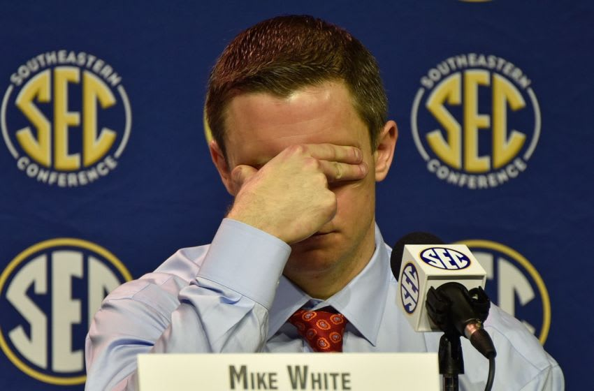 NASHVILLE, TENNESSEE - MARCH 11: Head coach Mike White of the Florida Gators rubs his eyes during a press conference after a 66-72 loss against the Texas A&M Aggies in an SEC Tournament Quarterfinal game at Bridgestone Arena on March 11, 2016 in Nashville, Tennessee. (Photo by Frederick Breedon/Getty Images)