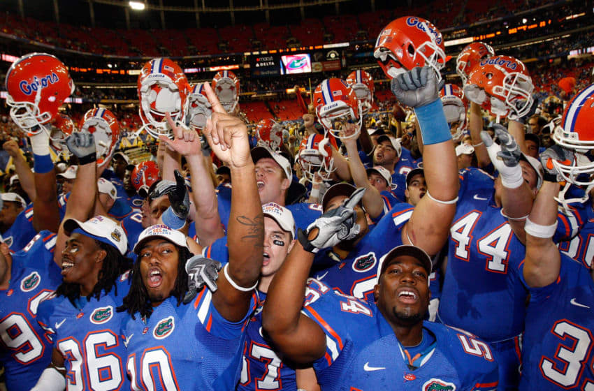 ATLANTA - DECEMBER 06: Members of the Florida Gators celebrate their 31-20 win over the Alabama Crimson Tide to win the SEC Championship on December 6, 2008 at the Georgia Dome in Atlanta, Georgia. (Photo by Chris Graythen/Getty Images)
