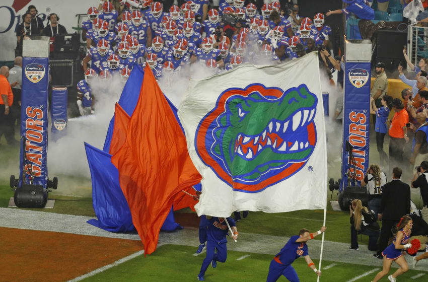 MIAMI GARDENS, FL - DECEMBER 30: The Florida Gators enter the field for the game against the Virginia Cavaliers at the Capital One Orange Bowl at Hard Rock Stadium on December 30, 2019 in Miami Gardens, Florida. Florida defeated Virginia 36-28. (Photo by Joel Auerbach/Getty Images)
