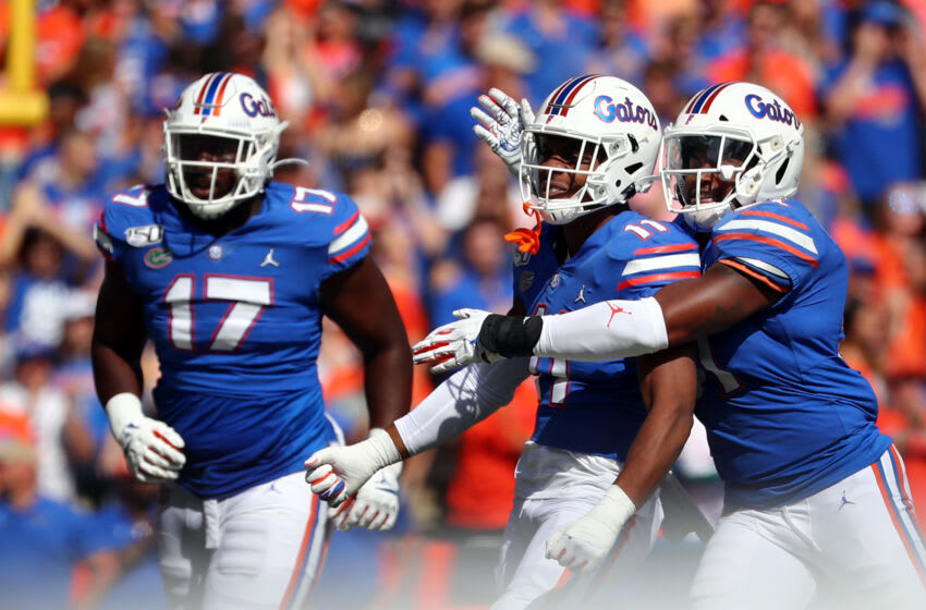 Nov 9, 2019; Gainesville, FL, USA; Florida Gators linebacker Mohamoud Diabate (11) is congratulated by linebacker Ventrell Miller (51) defensive lineman Zachary Carter (17) after a sack against the Vanderbilt Commodores during the first quarter at Ben Hill Griffin Stadium. Mandatory Credit: Kim Klement-USA TODAY Sports