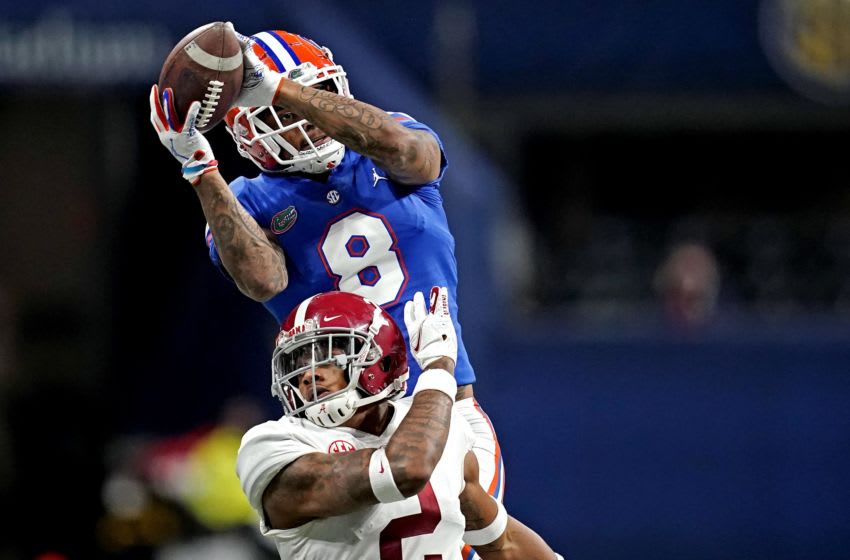 Dec 19, 2020; Atlanta, Georgia, USA; Florida Gators wide receiver Trevon Grimes (8) catches a touchdown against Alabama Crimson Tide running back Keilan Robinson (2) during the third quarter in the SEC Championship at Mercedes-Benz Stadium. Mandatory Credit: Dale Zanine-USA TODAY Sports