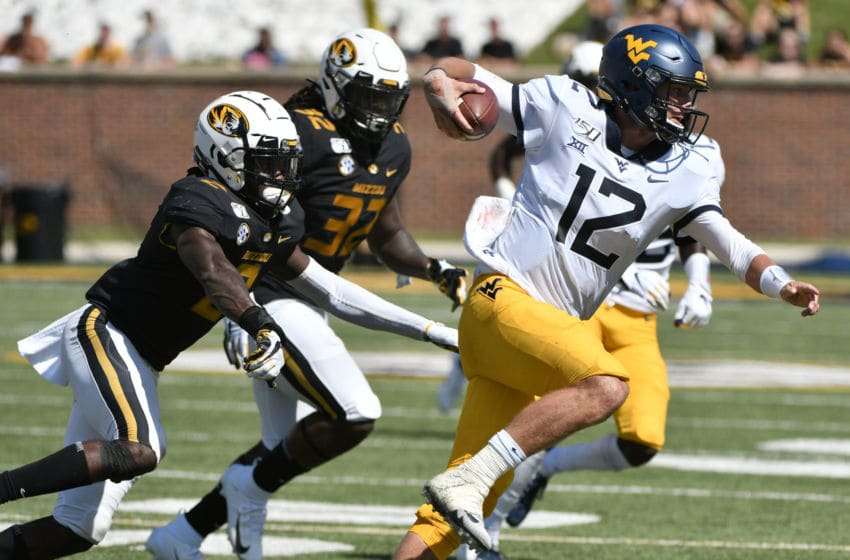 COLUMBIA, MISSOURI - SEPTEMBER 07: Quarterback Austin Kendall #12 of the West Virginia Mountaineers rushes past defensive back DeMarkus Acy #2 of the Missouri Tigers in the first half at Faurot Field/Memorial Stadium on September 07, 2019 in Columbia, Missouri. (Photo by Ed Zurga/Getty Images)