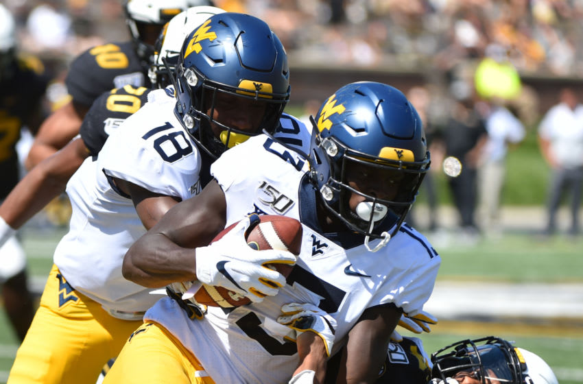 COLUMBIA, MISSOURI - SEPTEMBER 07: Wide receiver Sam James #13 of the West Virginia Mountaineers is tackled by defensive back Adam Sparks #14 of the Missouri Tigers in the fourth quarter at Faurot Field/Memorial Stadium on September 07, 2019 in Columbia, Missouri. (Photo by Ed Zurga/Getty Images)