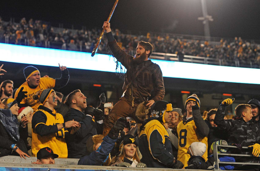 MORGANTOWN, WV - DECEMBER 03: The West Virginia Mountaineer mascot interacts with fans in the final moments of the West Virginia Mountaineers 24-21 win over the Baylor Bears at Mountaineer Field on December 3, 2016 in Morgantown, West Virginia. (Photo by Justin Berl/Getty Images)