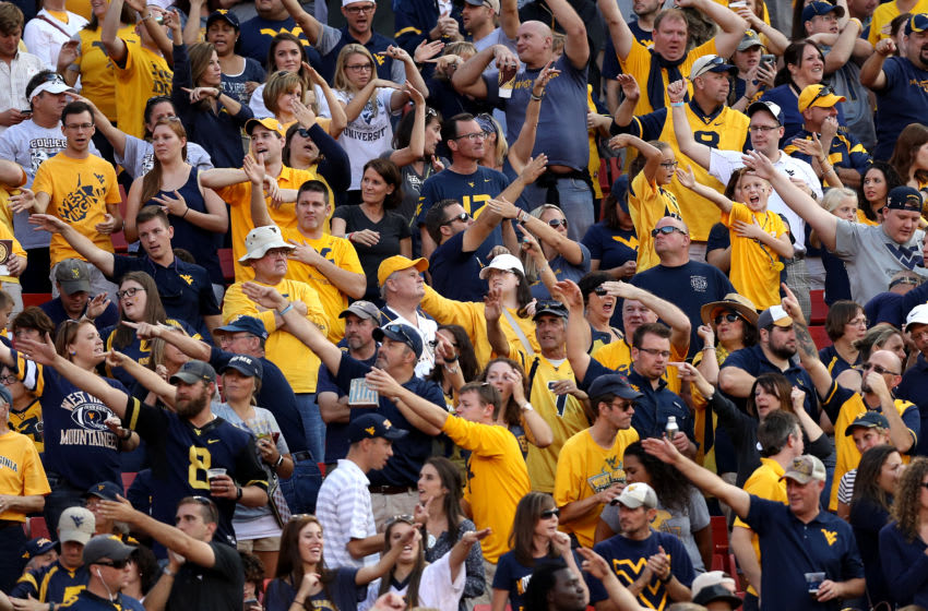 LANDOVER, MD - SEPTEMBER 24: West Virginia Mountaineers fans celebrate a first down against the Brigham Young Cougars during the second half at FedExField on September 24, 2016 in Landover, Maryland. (Photo by Patrick Smith/Getty Images)
