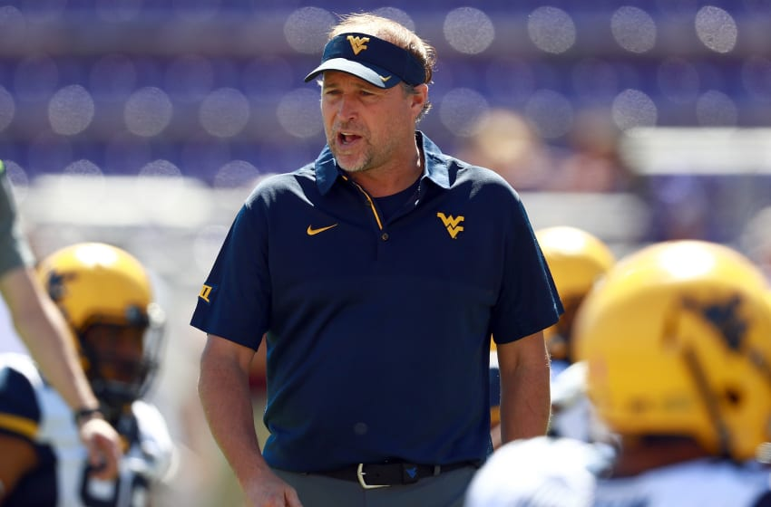 FORT WORTH, TX - OCTOBER 07: Head coach Dana Holgorsen of the West Virginia Mountaineers looks on as the West Virginia Mountaineers prepare to take on the TCU Horned Frogs at Amon G. Carter Stadium on October 7, 2017 in Fort Worth, Texas. (Photo by Tom Pennington/Getty Images)