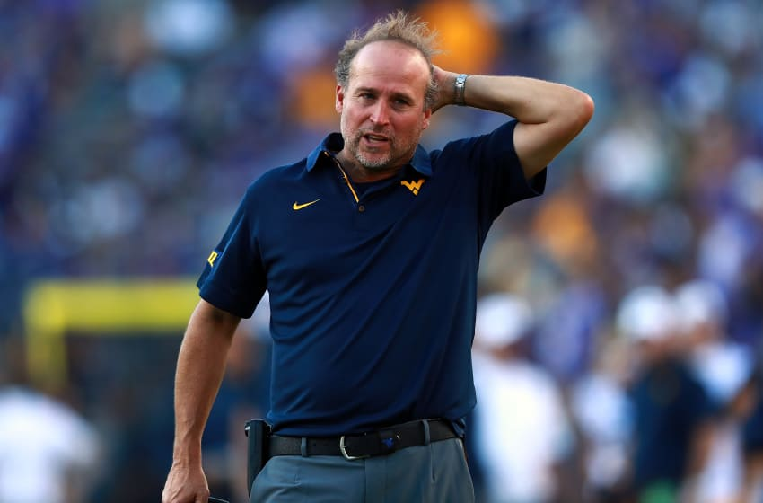 FORT WORTH, TX - OCTOBER 07: Head coach Dana Holgorsen of the West Virginia Mountaineers reacts to a play against the TCU Horned Frogs in the fourth quarter at Amon G. Carter Stadium on October 7, 2017 in Fort Worth, Texas. (Photo by Tom Pennington/Getty Images)