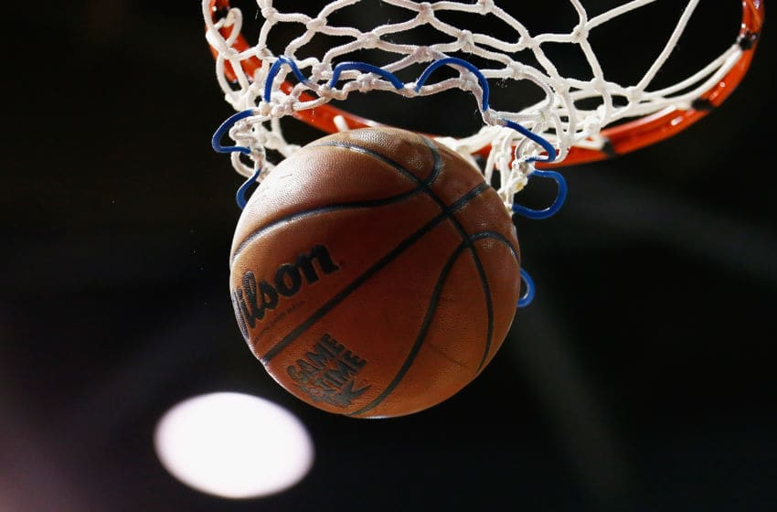 BRISBANE, AUSTRALIA - JANUARY 27: A basketball goes through the hoop during the round 16 NBL match between the Brisbane Bullets and the Adelaide 36ers at Brisbane Convention