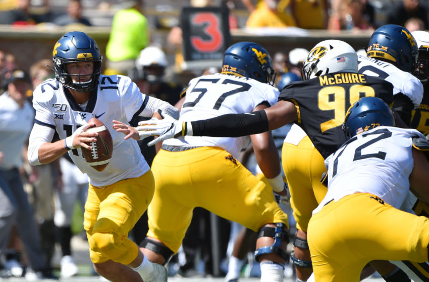 COLUMBIA, MISSOURI - SEPTEMBER 07: Quarterback Austin Kendall #12 of the West Virginia Mountaineers rolls out as he looks to pass against the Missouri Tigers in the fourth quarter at Faurot Field/Memorial Stadium on September 07, 2019 in Columbia, Missouri. (Photo by Ed Zurga/Getty Images)