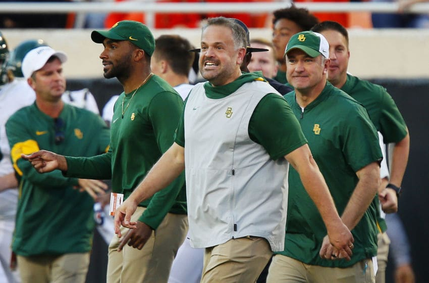 STILLWATER, OK - OCTOBER 19: Head coach Matt Rhule of the Baylor University Bears grins as he heads onto the field after beating the Oklahoma State Cowboys on October 19, 2019 at Boone Pickens Stadium in Stillwater, Oklahoma. Baylor stayed undefeated with a 45-27 road win. (Photo by Brian Bahr/Getty Images)