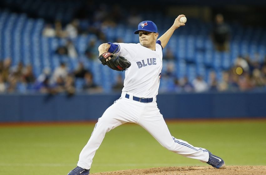 Jun 26, 2015; Toronto, Ontario, CAN; Toronto Blue Jays pitcher Rob Rasmussen (59) pitches against the Texas Rangers in the ninth inning at Rogers Centre. Toronto defeated Texas 12-2. Mandatory Credit: John E. Sokolowski-USA TODAY Sports