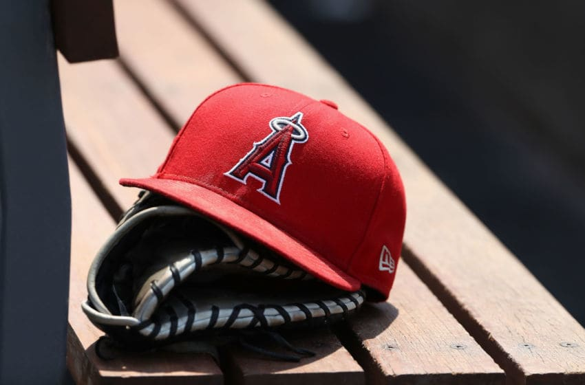LOS ANGELES, CA - JULY 15: A detailed view of an Los Angeles Angels of Anaheim hat and a catching glove is seen during the sixth inning of the MLB game between the Los Angeles Angels of Anaheim and the Los Angeles Dodgers at Dodger Stadium on July 15, 2018 in Los Angeles, California. The Dodgers defeated the Angels 5-3. (Photo by Victor Decolongon/Getty Images)