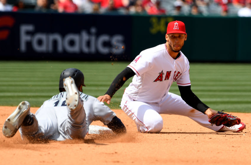 ANAHEIM, CA - APRIL 21: Domingo Santana #16 of the Seattle Mariners is out going for a double on a throw to Andrelton Simmons #2 of the Los Angeles Angels of Anaheim from Mike Trout in the fifth inning of the game at Angel Stadium of Anaheim on April 21, 2019 in Anaheim, California. (Photo by Jayne Kamin-Oncea/Getty Images)