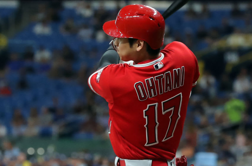 ST. PETERSBURG, FL - JUNE 13: Shohei Ohtani #17 of the Los Angeles Angels follows through on his single in the seventh inning of a baseball game against the Tampa Bay Rays at Tropicana Field on June 13, 2019 in St. Petersburg, Florida. (Photo by Mike Carlson/Getty Images)