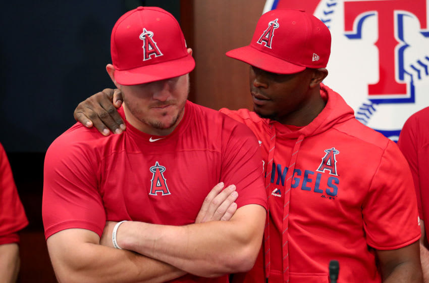 ARLINGTON, TEXAS - JULY 02: Mike Trout #27 of the Los Angeles Angels and Justin Upton #8 of the Los Angeles Angels talk with the media about the death of teammate Tyler Skaggs at Globe Life Park in Arlington on July 02, 2019 in Arlington, Texas. (Photo by Tom Pennington/Getty Images)