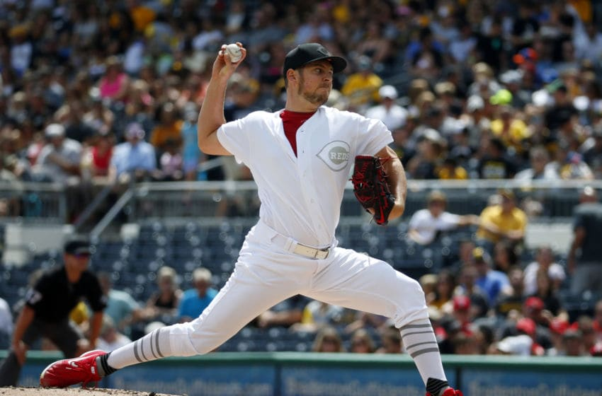 PITTSBURGH, PA - AUGUST 25: Trevor Bauer #27 of the Cincinnati Reds pitches in the first inning against the Pittsburgh Pirates at PNC Park on August 25, 2019 in Pittsburgh, Pennsylvania. Teams are wearing special color schemed uniforms with players choosing nicknames to display for Players' Weekend. (Photo by Justin K. Aller/Getty Images)