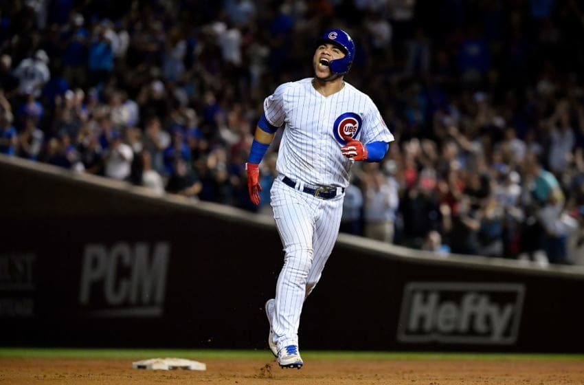 CHICAGO, ILLINOIS - SEPTEMBER 18: Willson Contreras #40 of the Chicago Cubs reacts after hitting a home run in the seventh inning against the Cincinnati Reds at Wrigley Field on September 18, 2019 in Chicago, Illinois. (Photo by Quinn Harris/Getty Images)