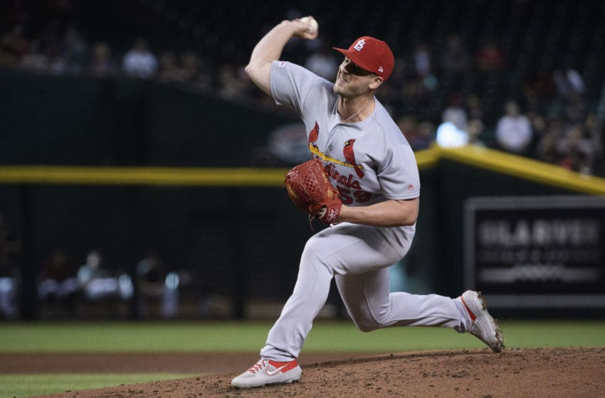PHOENIX, ARIZONA - SEPTEMBER 25: Mike Mayers #59 of the St. Louis Cardinals delivers a pitch in the second inning of the MLB game against the Arizona Diamondbacks at Chase Field on September 25, 2019 in Phoenix, Arizona. (Photo by Jennifer Stewart/Getty Images)