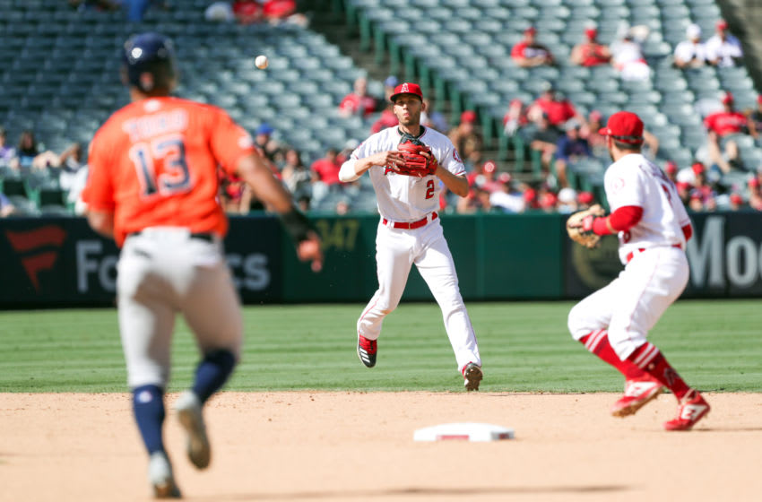 ANAHEIM, CALIFORNIA - SEPTEMBER 29: Andrelton Simmons #2 of the Los Angeles Angels of Anaheim tosses the ball to David Fletcher #5 for the force out in the seventh inning of Abraham Toro #13 of the Houston Astros at Angel Stadium of Anaheim on September 29, 2019 in Anaheim, California. (Photo by Kent Horner/Getty Images)