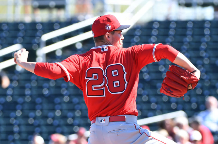 GOODYEAR, ARIZONA - MARCH 03: Andrew Heaney #28 of the Los Angeles Angels delivers a first inning pitch against the Cleveland Indians during a spring training game at Goodyear Ballpark on March 03, 2020 in Goodyear, Arizona. (Photo by Norm Hall/Getty Images)