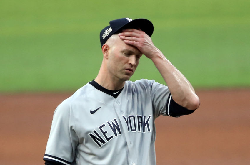 SAN DIEGO, CALIFORNIA - OCTOBER 06: J.A. Happ #33 of the New York Yankees reacts after allowing a two run home run to Mike Zunino (not pictured) of the Tampa Bay Rays during the second inning in Game Two of the American League Division Series at PETCO Park on October 06, 2020 in San Diego, California. (Photo by Sean M. Haffey/Getty Images)