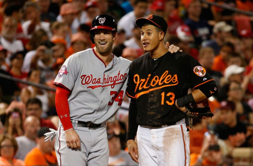 BALTIMORE, MD - JULY 10: Bryce Harper #34 of the Washington Nationals and Manny Machado #13 of the Baltimore Orioles talk during their game at Oriole Park at Camden Yards on July 10, 2015 in Baltimore, Maryland. (Photo by Rob Carr/Getty Images)