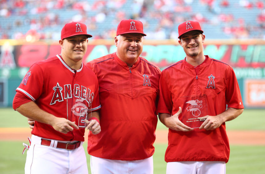 Mike Trout, Mike Scioscia, Andrew Heaney, Los Angeles Angels (Photo by Victor Decolongon/Getty Images)