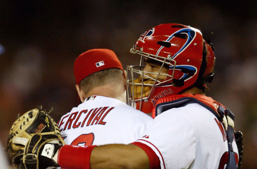 ANAHEIM, CA - JULY 27: Catcher Jose Molina #28 hugs relief pitcher Troy Percival #40 of the Anaheim Angels at the conclusion of the game against the Texas Rangers on July 27, 2004 at Angel Stadium in Anaheim, California. Percival retired the side in order to pick up his 299th career save and his 16th of the season as the Angels won 2-0. (Photo by Stephen Dunn/Getty Images)
