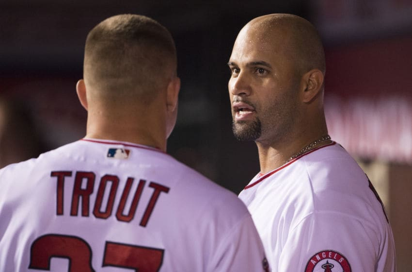ANAHEIM, CA - MAY 11: Albert Pujols #5 of the Los Angeles Angels of Anaheim talks to Mike Trout #27 in the dugout during the game against the St. Louis Cardinals at Angel Stadium of Anaheim on May 11, 2016 in Anaheim, California. (Photo by Matt Brown/Angels Baseball LP/Getty Images)