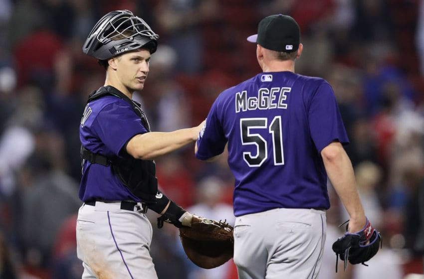 BOSTON, MA - MAY 26: Jake McGee #51 of the Colorado Rockies and Dustin Garneau #13 celebrate after defeating the Boston Red Sox 8-2 at Fenway Park on May 26, 2016 in Boston, Massachusetts. (Photo by Maddie Meyer/Getty Images)