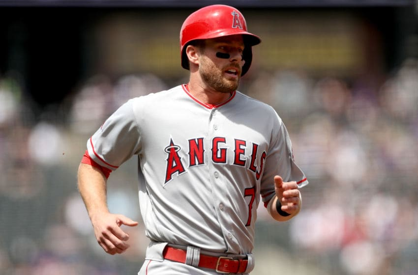 DENVER, CO - MAY 09: Zack Cozart #7 of the Los Angeles Angels of Anaheim scores on a Mike Trout single in the first inning against the Colorado Rockies at Coors Field on May 9, 2018 in Denver, Colorado. (Photo by Matthew Stockman/Getty Images)