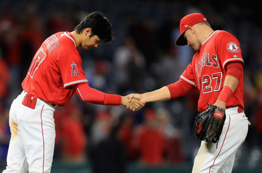 ANAHEIM, CA - MAY 10: Shohei Ohtani #17 shakes hands with Mike Trout #27 of the Los Angeles Angels of Anaheim after defeating the Minnesota Twins 7-4 in a game at Angel Stadium on May 10, 2018 in Anaheim, California. (Photo by Sean M. Haffey/Getty Images)