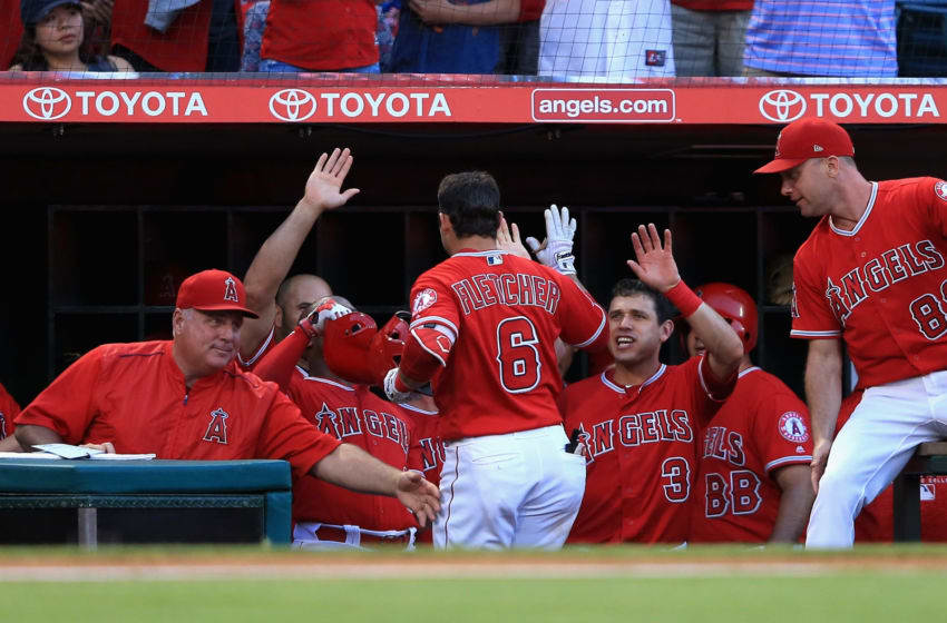 ANAHEIM, CA - JULY 12: Manager Mike Scioscia, Ian Kinsler #3 and Albert Pujols #5 congratulate David Fletcher #6 of the Los Angeles Angels of Anaheim after his solo homerun during the first nning of a game against the Seattle Mariners at Angel Stadium on July 12, 2018 in Anaheim, California. (Photo by Sean M. Haffey/Getty Images)