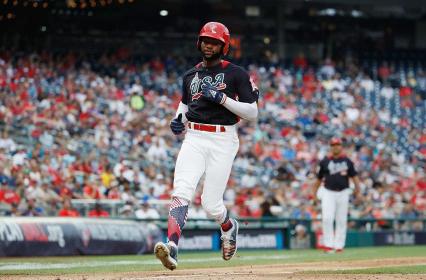 WASHINGTON, DC - JULY 15: Jo Adell of the U.S. Team scores on a passed ball against the World Team in the seventh inning during the SiriusXM All-Star Futures Game at Nationals Park on July 15, 2018 in Washington, DC. (Photo by Patrick McDermott/Getty Images)