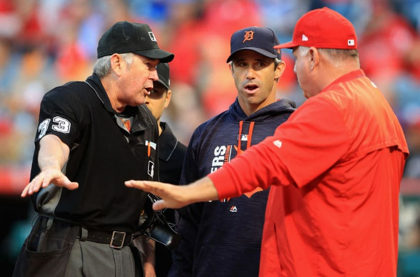 ANAHEIM, CA - MAY 11: Manager Brad Ausmus of the Detroit Tigers talks with manager Mike Scioscia of the Los Angeles Angels of Anaheim and umpire Mike Winters prior to a game at Angel Stadium of Anaheim on May 11, 2017 in Anaheim, California. (Photo by Sean M. Haffey/Getty Images)