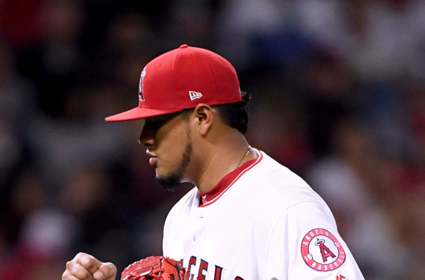 ANAHEIM, CA - JUNE 01: Jaime Barria #51 of the Los Angeles Angels reacts to his strikeout of Jurickson Profar #19 of the Texas Rangers to end the sixth inning at Angel Stadium on June 1, 2018 in Anaheim, California. (Photo by Harry How/Getty Images)