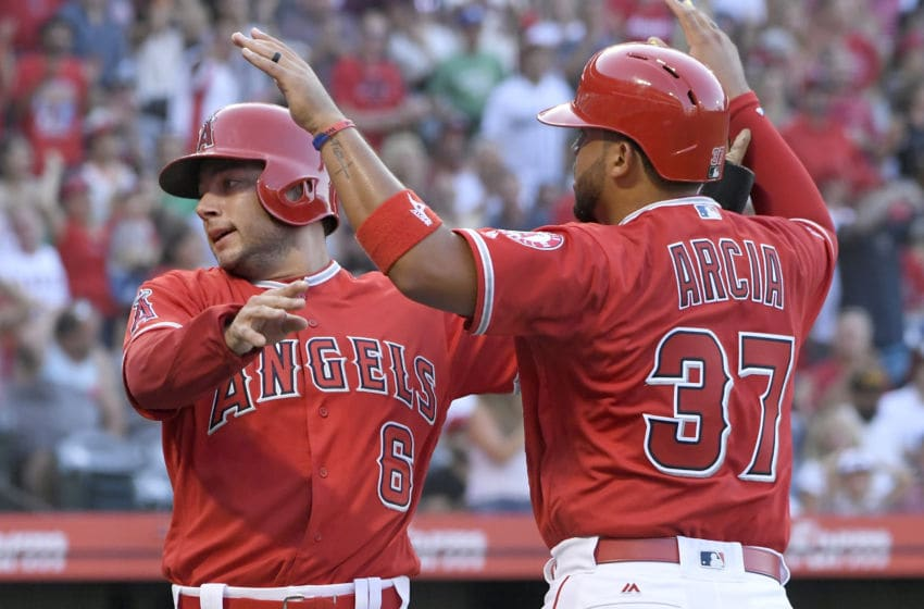 ANAHEIM, CA - JULY 28: David Fletcher #6 of the Los Angeles Angels of Anaheim is congratulated by Francisco Arcia #37 after he was driven in by Kole Calhoun in the second inning against the Seattle Mariners at Angel Stadium on July 28, 2018 in Anaheim, California. (Photo by John McCoy/Getty Images)