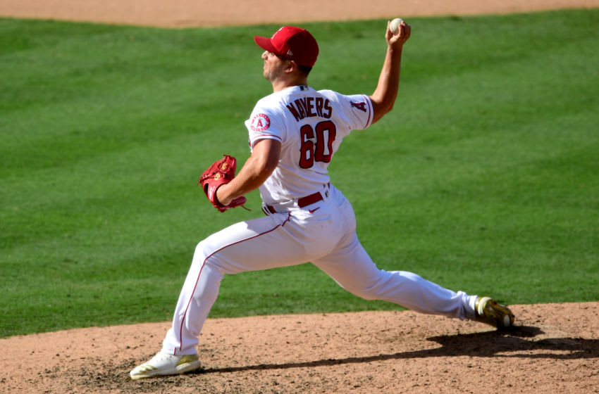 ANAHEIM, CA - SEPTEMBER 21: Mike Mayers #60 of the Los Angeles Angels earns a save pitching in the ninth inning of the game against the Texas Rangers at Angel Stadium of Anaheim on September 21, 2020 in Anaheim, California. (Photo by Jayne Kamin-Oncea/Getty Images)