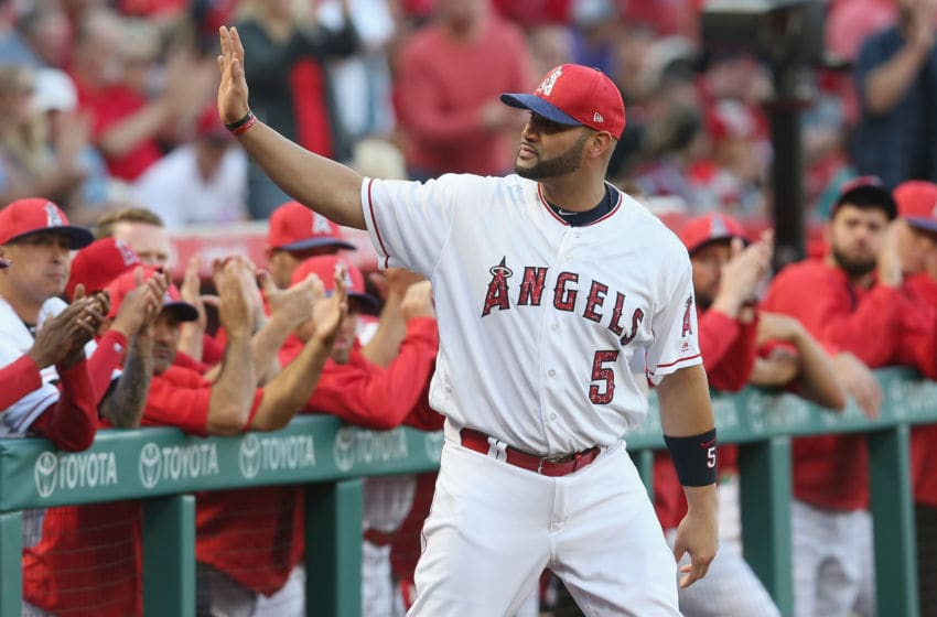 ANAHEIM, CALIFORNIA - JULY 01: Albert Pujols #5 (C) of the Los Angeles Angels of Anaheim waves to fans as he takes the field for a ceremony commemorating hitting his 600th home earlier this season before the game with the Seattle Mariners at Angel Stadium of Anaheim on July 1, 2017 in Anaheim, California. (Photo by Stephen Dunn/Getty Images)