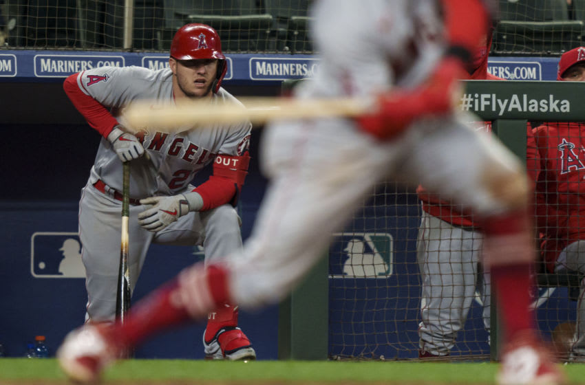 SEATTLE, WA - MAY 01: Mike Trout #27 of the Los Angeles Angels watches play from the dugout during a game against the Seattle Mariners at T-Mobile Park on May 1, 2021 in Seattle, Washington. The Angeles won 10-5. (Photo by Stephen Brashear/Getty Images)