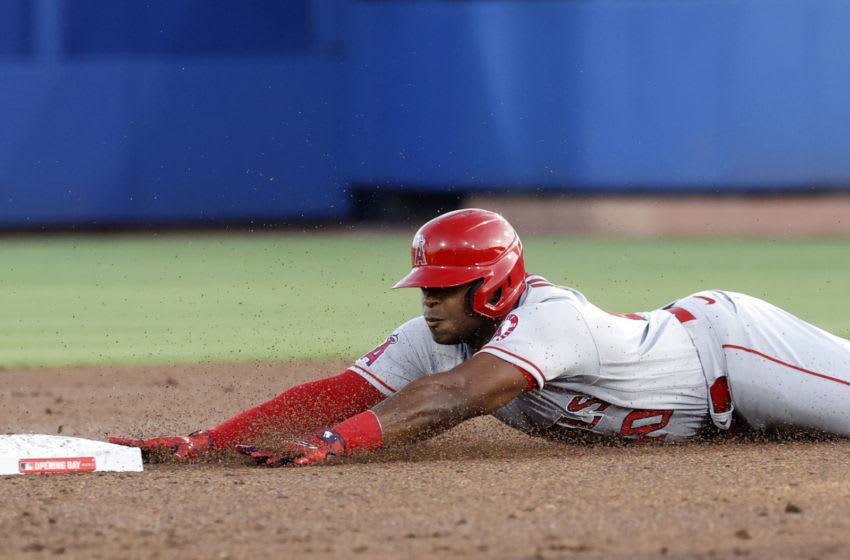 Apr 8, 2021; Dunedin, Florida, CAN; Los Angeles Angels left fielder Justin Upton (10) slides into second base after hitting a double during the second inning against the Toronto Blue Jays at TD Ballpark. Mandatory Credit: Kim Klement-USA TODAY Sports