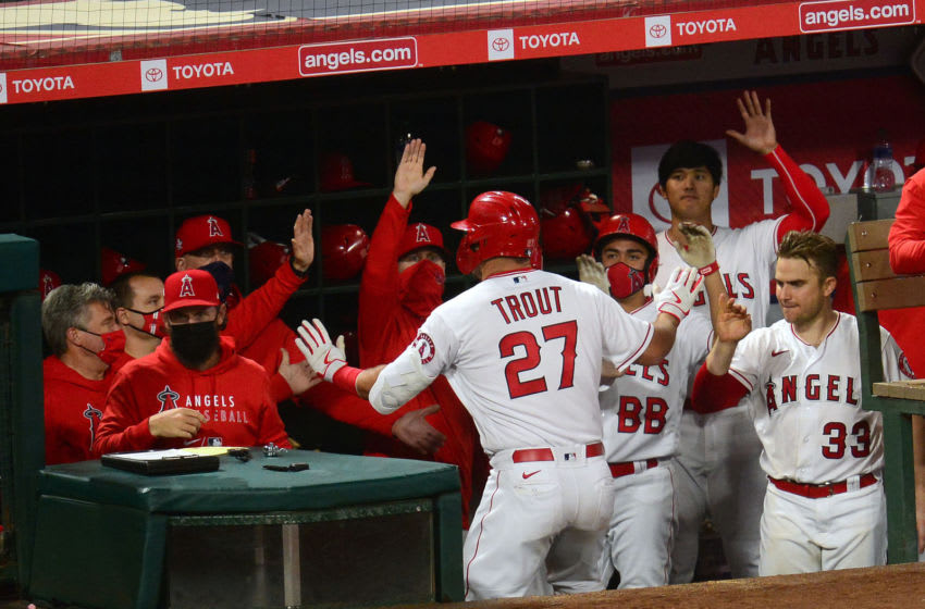 May 4, 2021; Anaheim, California, USA; Los Angeles Angels center fielder Mike Trout (27) is greeted after hitting a solo home run against the Tampa Bay Rays during the sixth inning at Angel Stadium. Mandatory Credit: Gary A. Vasquez-USA TODAY Sports